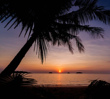 Beautiful sunset at the beach in the tropics. Sky and ocean. Background