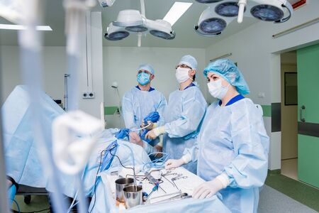 Arthroscope surgery. Orthopedic surgeons in teamwork in the operating room Stock Photo