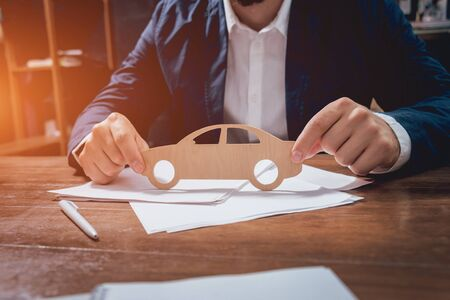 Man proposing signing a car insurance policy.