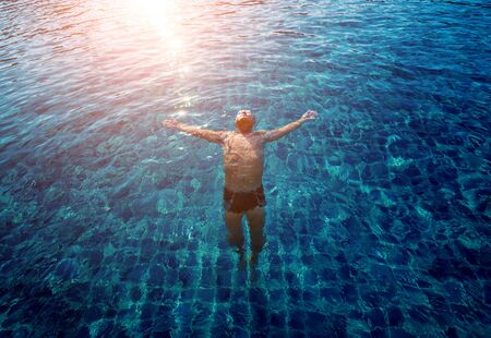 Young athletic man swimming in the swimming pool. Active sport Reklamní fotografie - 140550373
