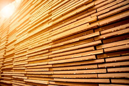 Stack of natural rough wooden boards. Wooden boards, lumber, industrial wood. Industrial timber