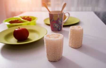 Bamboo toothbrushes, washcloths, cups and plates on the white table Zdjęcie Seryjne