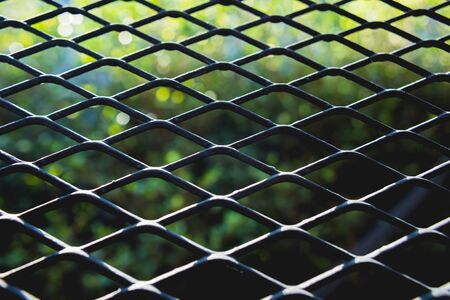 Abstract metal grid background. Lattice texture with big cells grid.