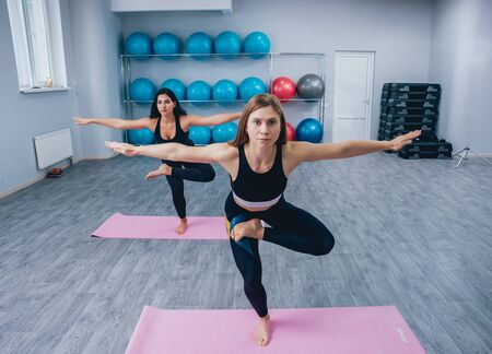 Sporty young women doing yoga practice at the gym. Fitness concept 스톡 콘텐츠