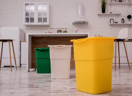 Recycle bins in the kitchen. Household waste sorting. Environmentally responsible behavior. Zero waste concept