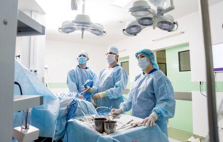 Arthroscope surgery. Orthopedic surgeons in teamwork in the operating room Stock Photo