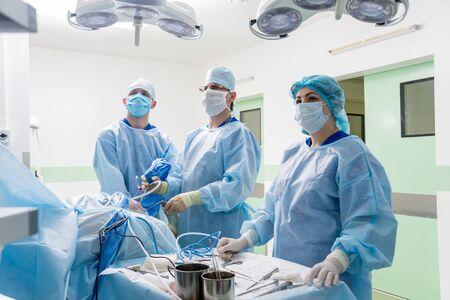 Arthroscope surgery. Orthopedic surgeons in teamwork in the operating room Zdjęcie Seryjne
