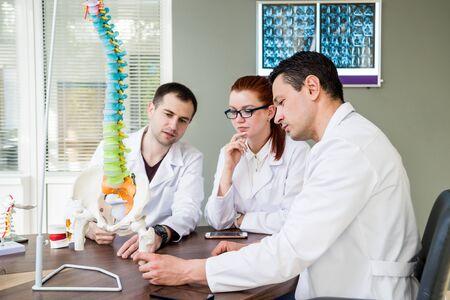 Doctors team having medical council in hospital. Imagens