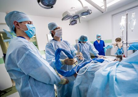 Arthroscope surgery. Orthopedic surgeons in teamwork in the operating room Stock fotó