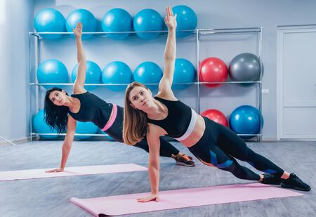 Young fitness women with blue fitballs. Crossfit training.