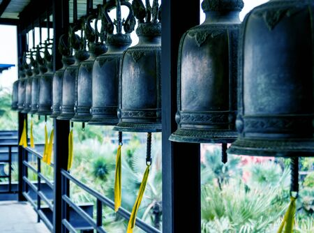 Symbols of Buddhism. Bells. South-Eastern Asia. Details of buddhist temple 写真素材