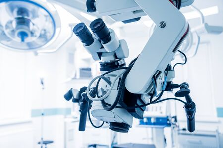 Modern microscope for operations in surgery room at the hospital. Background