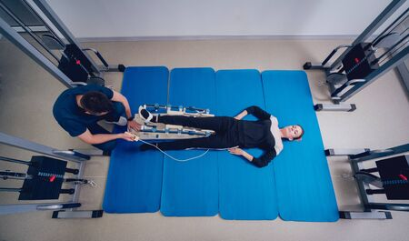 Patient on CPM machines. Continuous passive range of motion.