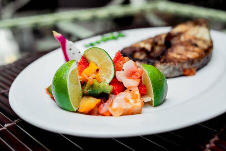 Vegetables on the white plate. Barbecue. Restaurant Banco de Imagens
