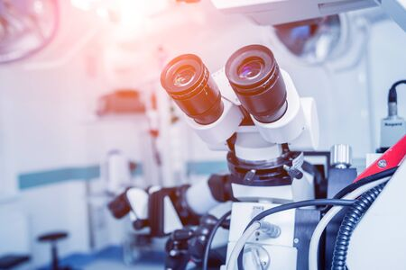 Modern microscope for operations in surgery room at the hospital. Background Stock Photo