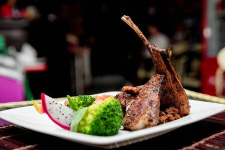 Roasted meat on the white plate. Barbecue. Restaurant