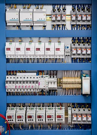 Voltage switchboard with circuit breakers. Modern electrical background. 스톡 콘텐츠