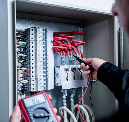 Electrical measurements with multimeter tester. Modern electrical background