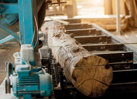 Modern sawmill. Industry sawing boards from logs. Background 版權商用圖片
