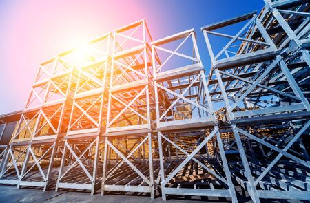 Structure of steel. Building construction on sky background. Texture