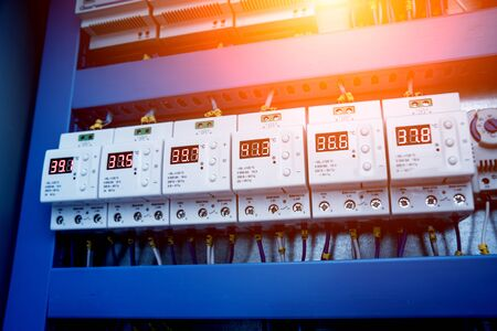 Voltage switchboard with circuit breakers. Modern electrical background.