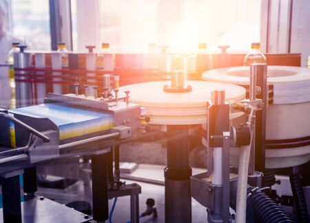 Automatic labeling machine during operation. Factory for the production Stock Photo