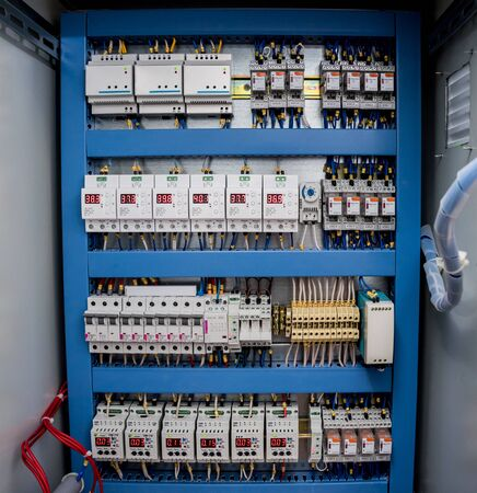 Voltage switchboard with circuit breakers. Modern electrical background