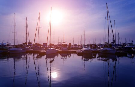 Beautiful view of marina and harbor with yachts and motorboats. Foto de archivo