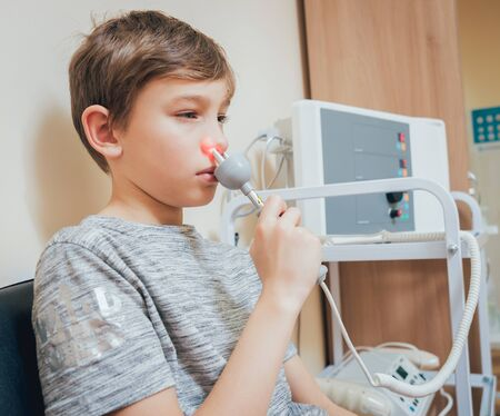 Treatment and warming-up the nose of a young boy.