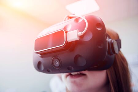 Eye treatment. Patient in virtual reality goggles. Checking the girl's vision with the help of virtual reality. Ortoptics. Pleoptics Stock Photo