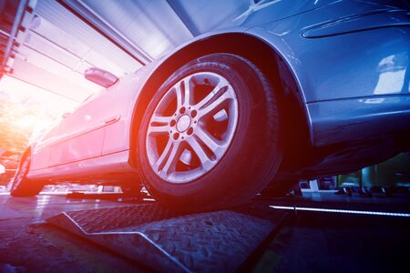Automotive suspension test and brake test rolls in a auto repair service. Background