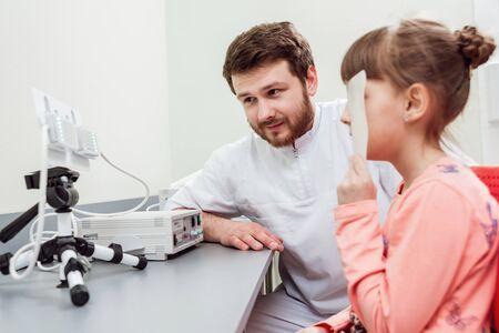 Orthoptics. Pleoptics. Doctor explains how to use ophthalmic equipment.