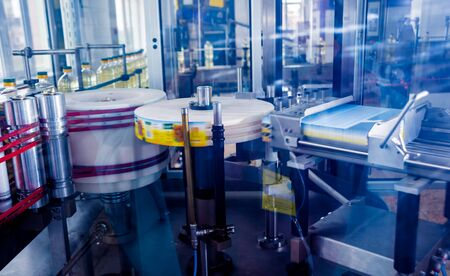 Automatic labeling machine during operation. Factory for the production