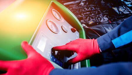 Servicing car air conditioner. Auto service station. Stock Photo