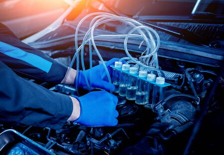 Cleaning engine injectors. Car repair. Auto service