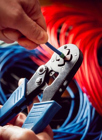 Electrical equipment. Electricity cable and crimper. Background and texture