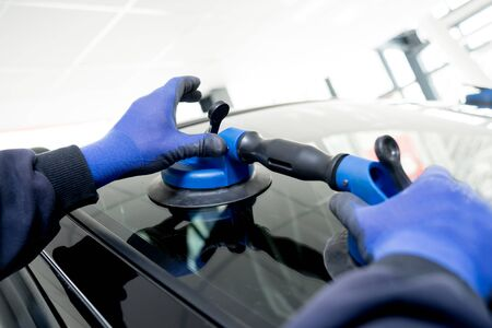 Automotive glazier equipment for replace windscreen. In auto service