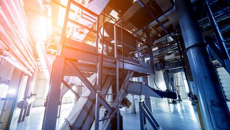Interior of modern natural oil factory. The piping, pumps and motors