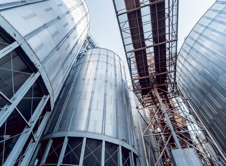 Modern silos for storing grain harvest. Agriculture. Background Stock Photo