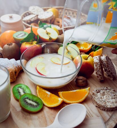 Beautiful breakfast. Milk fruits, bread and croissant. Background