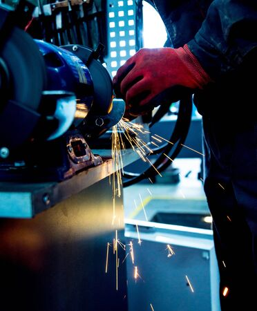 Grinding parts on a lathe. Auto repair service Stock Photo