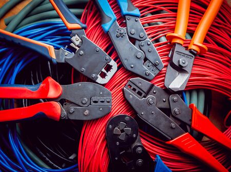 Electrical equipment. Electricity cable and crimper. Background Stockfoto