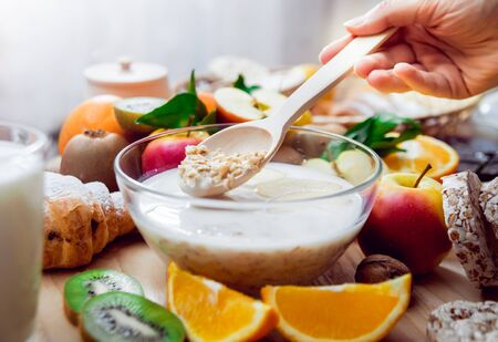 Beautiful breakfast. Milk fruits, bread and croissant. Background Stock Photo