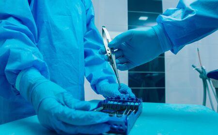 Dental tools on blue background. Preparation for dental surgery. Modern dental technologies