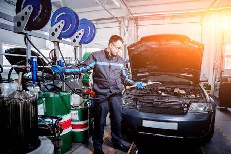 Engine oil change. Car repair. Auto background