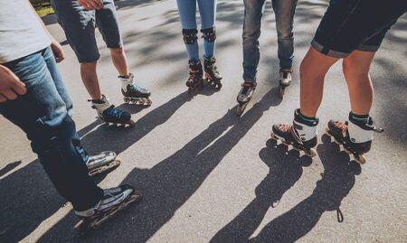 Legs wearing roller skating shoe. Outdoors. Skatepark