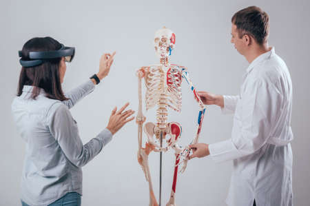 Doctor uses augmented reality goggles and human skeleton