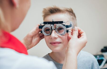 Trial frame. Glasses for a little boy. Ametropia correction with glasses.