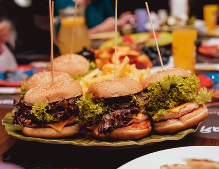 Bacon burgers with beef on wooden table
