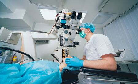 Eye surgery. A patient and surgeon in the operating room